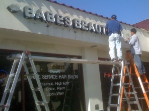 The store sign being installed for Babes Beauty Lounge
