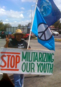 David Ledesma with his peace flag and sign.
