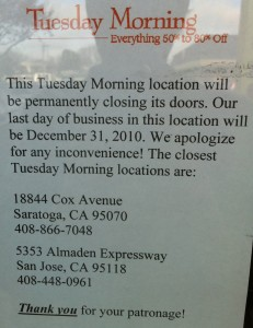 A flyer announces the closing of the store.